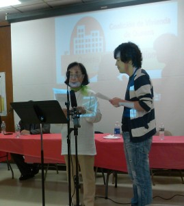 Corona resident Grace (left) addresses the press and QHC through a Korean interpreter