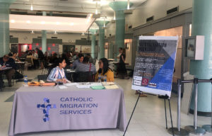 Women sitting at a Table for a Naturalization Workshop